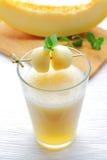 Melon juice. A delicious melon milkshake with fresh fruits Royalty Free Stock Photo