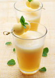 Melon juice. A delicious melon milkshake with fresh fruits Royalty Free Stock Photography