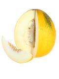 Melon mûr avec découpé en tranches au-dessus du blanc. D'isolement Photo libre de droits