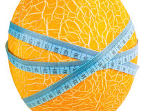 Melon with measuring tape Stock Images