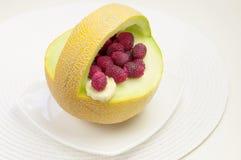 Melon med hallon Royaltyfria Bilder