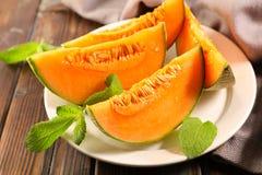 Melon mennica i plasterki fotografia royalty free