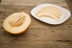 Melon na drewnianym stole zdjęcie royalty free