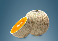 Melon and Orange inside Stock Image