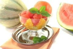 Melon orange salad Stock Photos