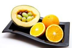 Melon with oranges Stock Photos
