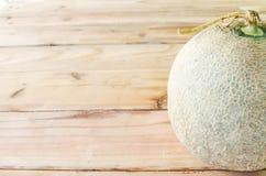 Melon på en trätappningstil Royaltyfria Bilder