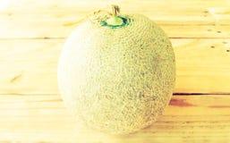 Melon på en trätappningstil Royaltyfria Foton