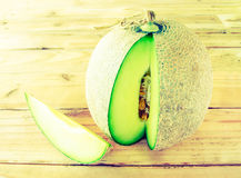 Melon på en trätappningstil Fotografering för Bildbyråer