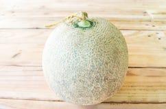 Melon på ett trä Arkivbild