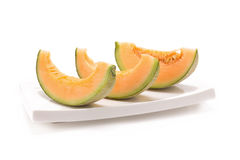 Melon på vit bakgrund Royaltyfri Bild