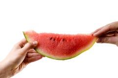 Melon pass. Man sharing melon with a women Royalty Free Stock Photos