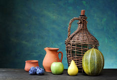 Melon, pear, apple, plum and ceramic dishes Stock Image