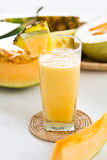 Melon and Pineapple smoothie. By fresh melon and pineapple Royalty Free Stock Photos
