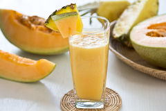 Melon and Pineapple smoothie. By fresh melon and pineapple Royalty Free Stock Photo