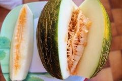 Melon on the plate served dinner stock images