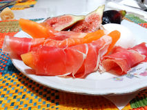 Melon with prosciutto. Dish with healthy food Stock Photos