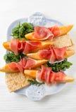 Melon and prosciutto snack Royalty Free Stock Photos