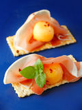 Melon and prosciutto snack Stock Images