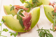 Melon and prosciutto Stock Image