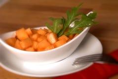 Melon salad with arugula salad Royalty Free Stock Images