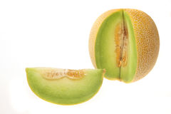 Melon and section. Galia melon with slice cut out isolated on white stock photos