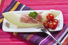 Melon slice with Parma ham Stock Photography