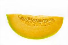 Melon slice. Slice of tasty, fresh melon on white background Stock Images