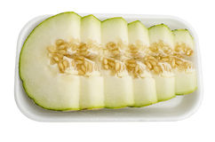 Melon sliced. On a white background Royalty Free Stock Images