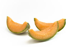 Melon slices. Melon pieces lying together on white background royalty free stock photos