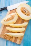 Melon slices on a cutting board Stock Image