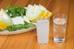 Melon slices and feta cheese and mint with turkish raki Royalty Free Stock Photography