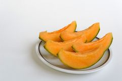 Melon slices in the foreground. Closeup of juicy slices of melon, Swiss organic product Royalty Free Stock Image
