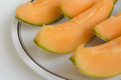 Melon slices in the foreground. Closeup of juicy slices of melon, Swiss organic product Royalty Free Stock Photography
