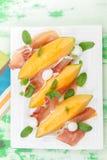 Melon slices with Prosciutto and mozzarella Stock Photography