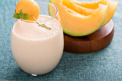 Melon smoothie on a table Royalty Free Stock Photos