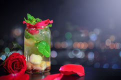 Melon soda with red rose decoration royalty free stock photo