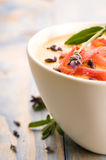 Melon soup with parma ham and lavender Stock Photos