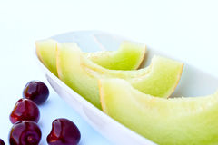 Melon still life. With cherry Royalty Free Stock Photos