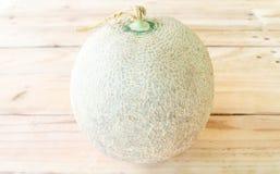 Melon sur un en bois Images stock