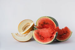 Melon, watermelon and pumpkin sliced on a white background Stock Image