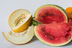 Melon, watermelon and pumpkin sliced on a white background Royalty Free Stock Images