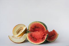 Melon, watermelon and pumpkin sliced on a white background Royalty Free Stock Photos