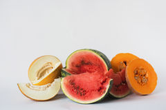 Melon, watermelon and pumpkin sliced on a white background Stock Photos