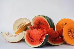Melon, watermelon and pumpkin sliced on a white background Royalty Free Stock Photo