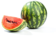 Melon whole and pieces,  on white Stock Photos