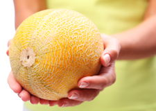 Melon in woman hands. Royalty Free Stock Photos
