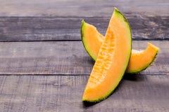 Melon. On wood table, fresh fruit royalty free stock photo