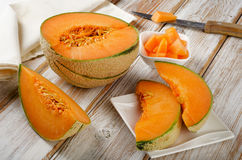 Melon on  a wooden table. Royalty Free Stock Photo