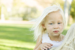 Meloncholy Portrait of Cute Little Girl Outside Royalty Free Stock Image